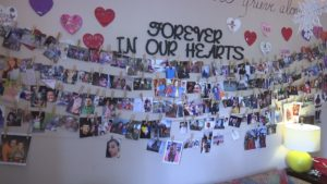 The memory wall shows dozens of photos of loved ones in happier times. (Credit: WINK News)