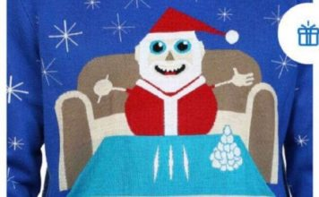 The sweater showed Santa with three lines of a white substance with the phrase let it snow. (Credit: Walmart)