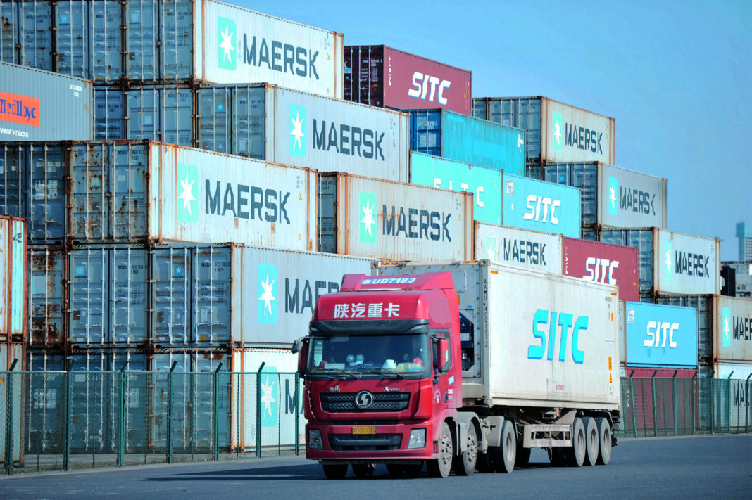 FILE: This photo taken on October 14, 2019 shows containers stacked at the port in Qingdao, in China's eastern Shandong province. (Photo by STR / AFP) / China OUT (Photo by STR/AFP via Getty Images)