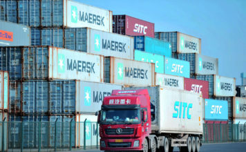 This photo taken on October 14, 2019 shows containers stacked at the port in Qingdao, in China's eastern Shandong province. - China's imports and exports fell more than expected in September, official data showed on October 14, as US tariffs and cooling demand at home and abroad hit trade in the world's second largest economy. (Photo by STR / AFP) / China OUT (Photo by STR/AFP via Getty Images)