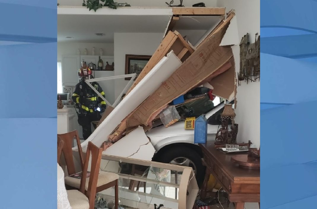 Person drove into a North Port home. (Credit: North Port Fire Rescue)
