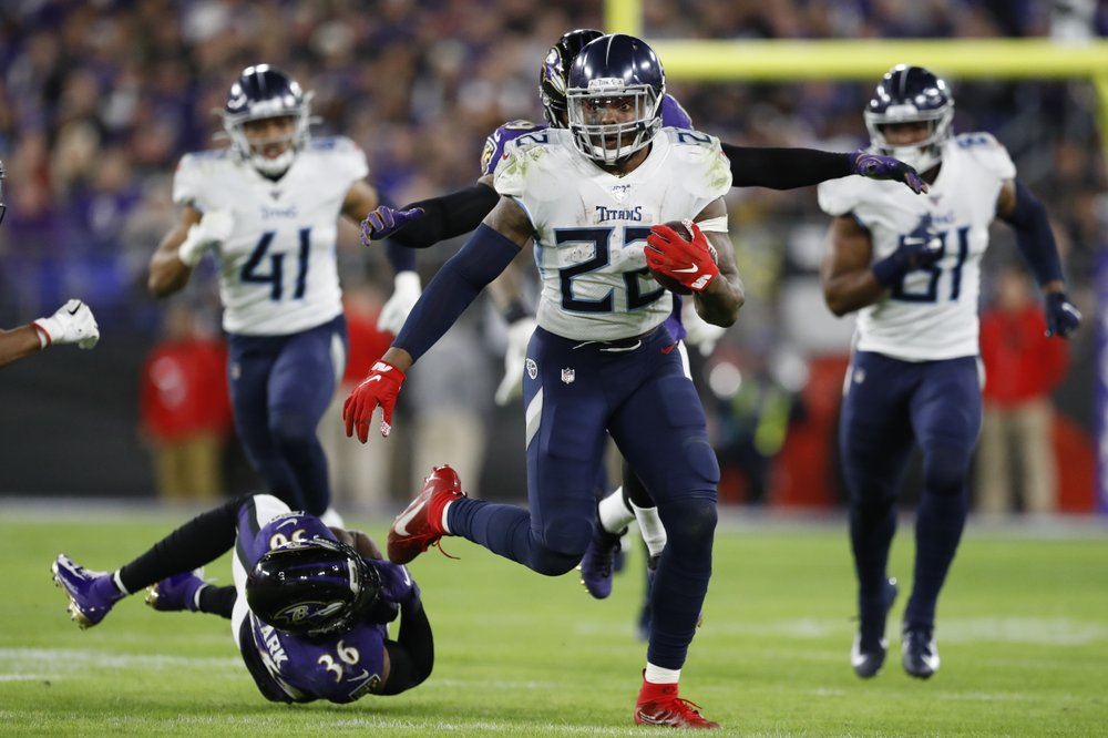 Tennessee Titans running back Derrick Henry (22) runs past Baltimore Ravens strong safety Chuck Clark (36) during the second half of an NFL divisional playoff football game, Saturday, Jan. 11, 2020, in Baltimore. (AP Photo/Julio Cortez)