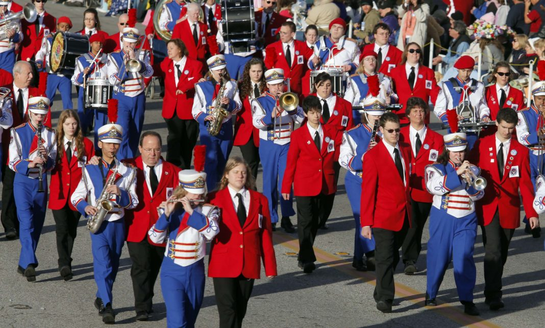 Ohio State School for the Blind Marching band led by guides moves along Colorado Blvd. during the 121st Rose Parade in Pasadena Calif., on Friday, Jan 1, 2010. (AP Photo/Richard Vogel)