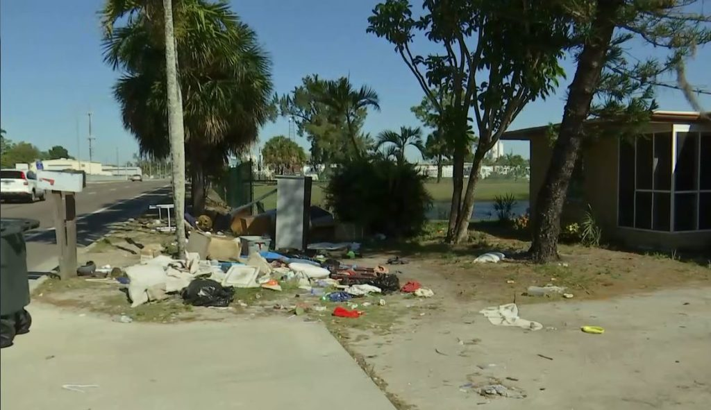 Trash pile eyesore finally removed from front of Fort Myers home