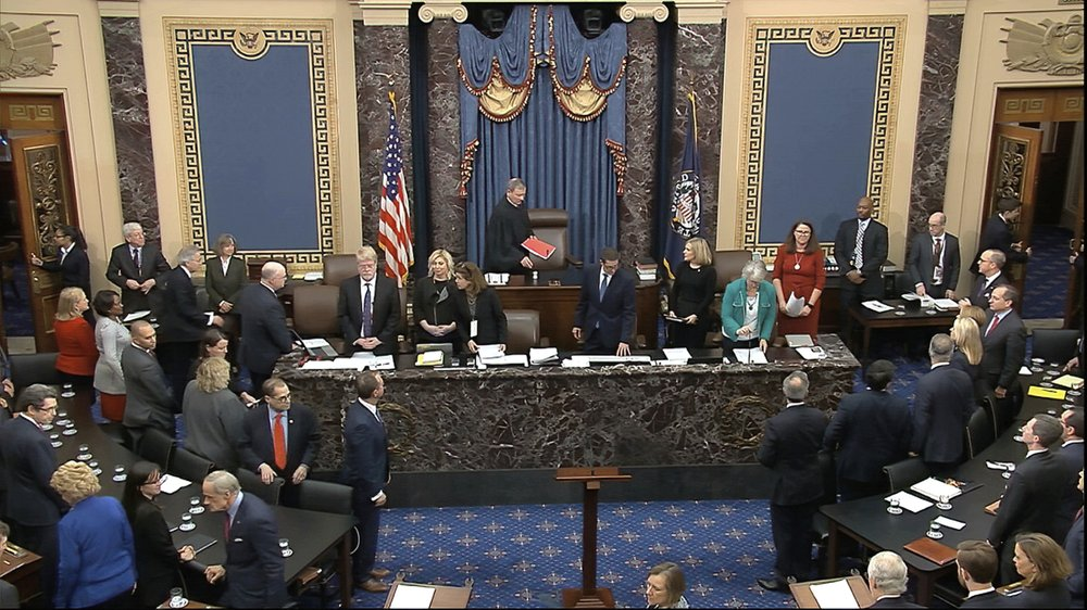 FILE: In this image from video, Chief Justice of the United States John Roberts arrives for the vote in the impeachment trial against President Donald Trump in the Senate at the U.S. Capitol in Washington, Wednesday, Feb. 5, 2020. (Senate Television via AP/FILE)
