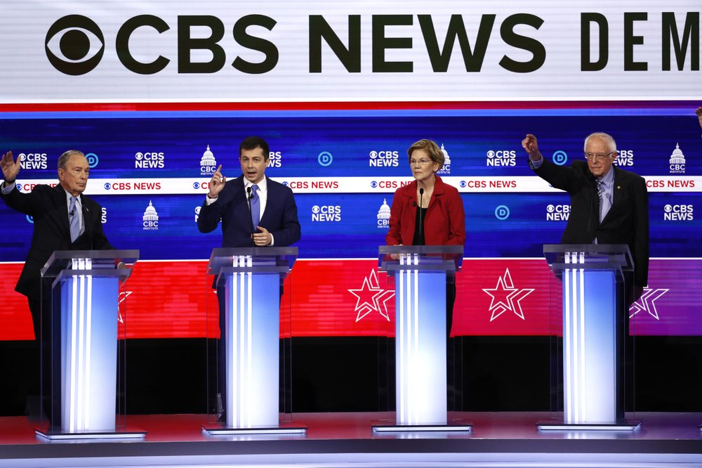 From left, Democratic presidential candidates, former New York City Mayor Mike Bloomberg, former South Bend Mayor Pete Buttigieg, Sen. Elizabeth Warren, D-Mass., and Sen. Bernie Sanders, I-Vt., participate in a Democratic presidential primary debate at the Gaillard Center, Tuesday, Feb. 25, 2020, in Charleston, S.C., co-hosted by CBS News and the Congressional Black Caucus Institute. (AP Photo/Patrick Semansky)
