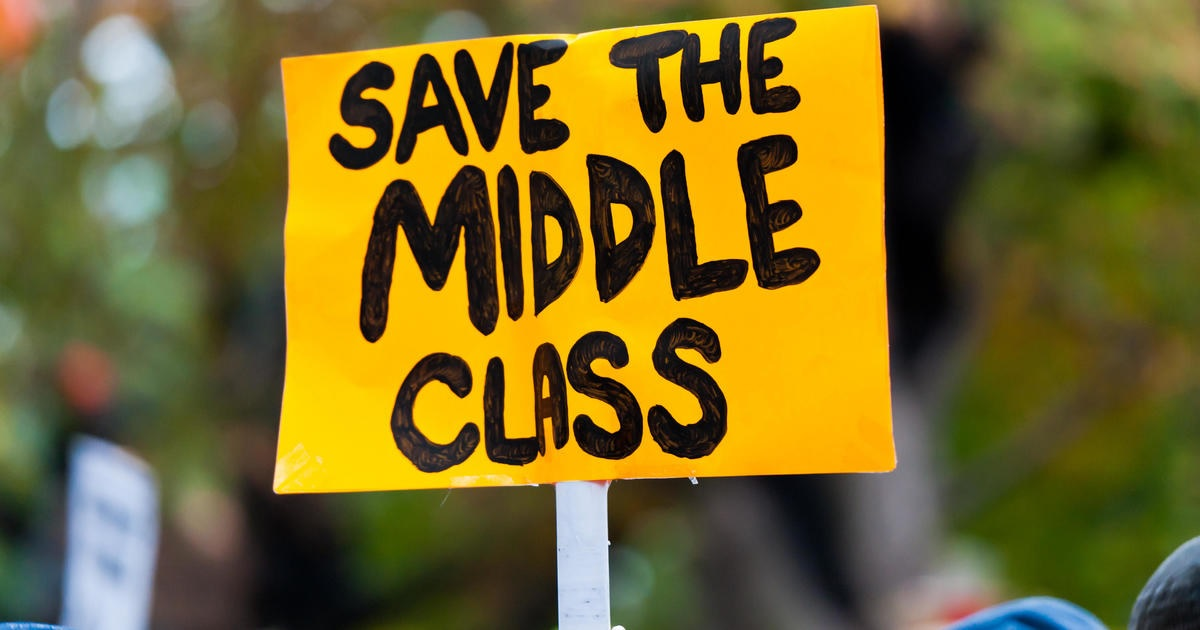 It now takes up to 66 weeks to pay for 52 weeks of middle-class basics. (Credit: CBS News)