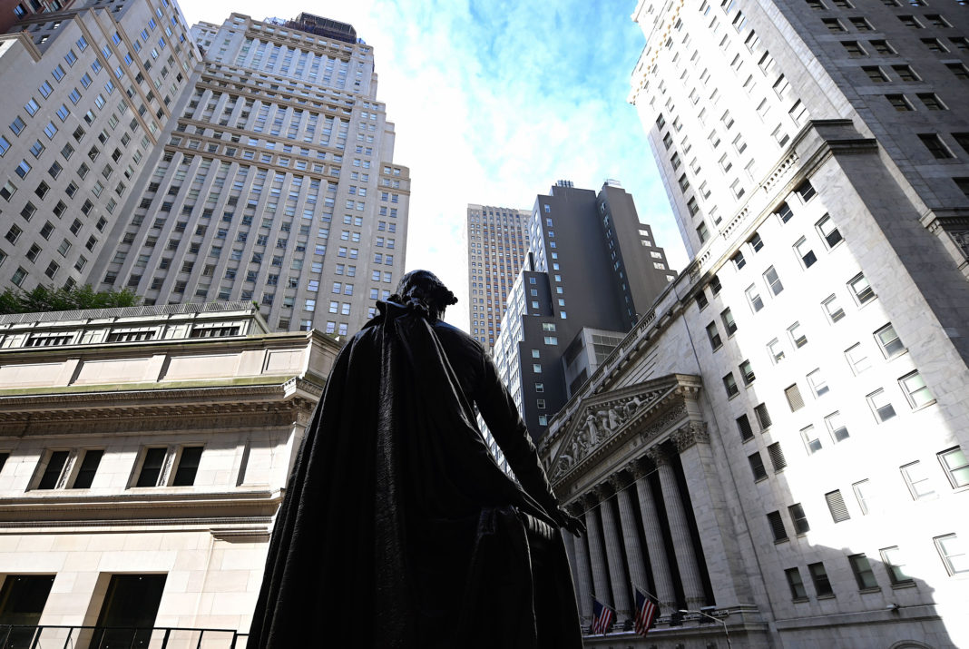 The statue of George Washington is seen in front of the New York Stock Exchange (NYSE) on October 11, 2019 at Wall Street in New York City. - Wall Street stocks jumped early Friday on optimism for progress in US-China negotiations, including a possible agreement to pause new tariff measures. The talks in Washington, now in their second day, were given a positive push by US President Donald Trump, who said the negotiations were