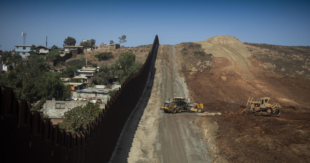 The Trump administration on Thursday announced it plans to make yet another multi-billion-dollar transfer of Pentagon funds to finance the construction of barriers along the U.S.-Mexico border, tapping into money originally allocated for military weapons and hardware. (Credit: CBS News)