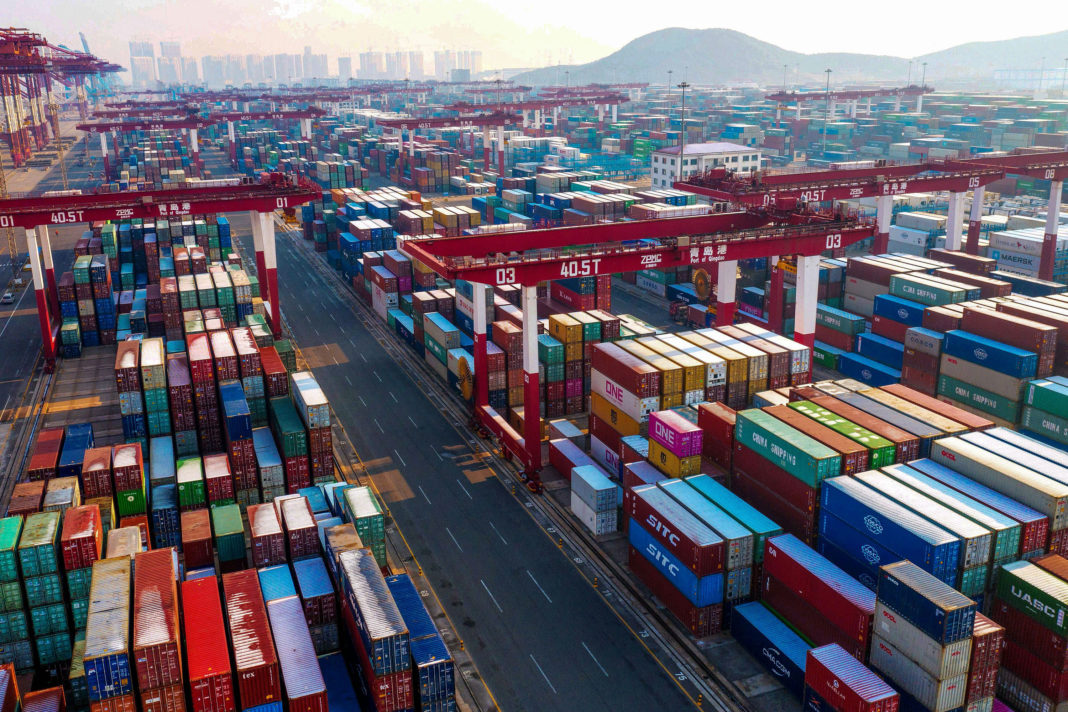 Containers are seen stacked at a port in Qingdao in China's eastern Shandong province on January 14, 2020. - China's trade surplus with the United States narrowed last year as the world's two biggest economies exchanged punitive tariffs in a bruising trade war, official data showed on January 14, on the eve of a deal to ease tensions. (Photo by STR / AFP) (Photo by STR/AFP via Getty Images)