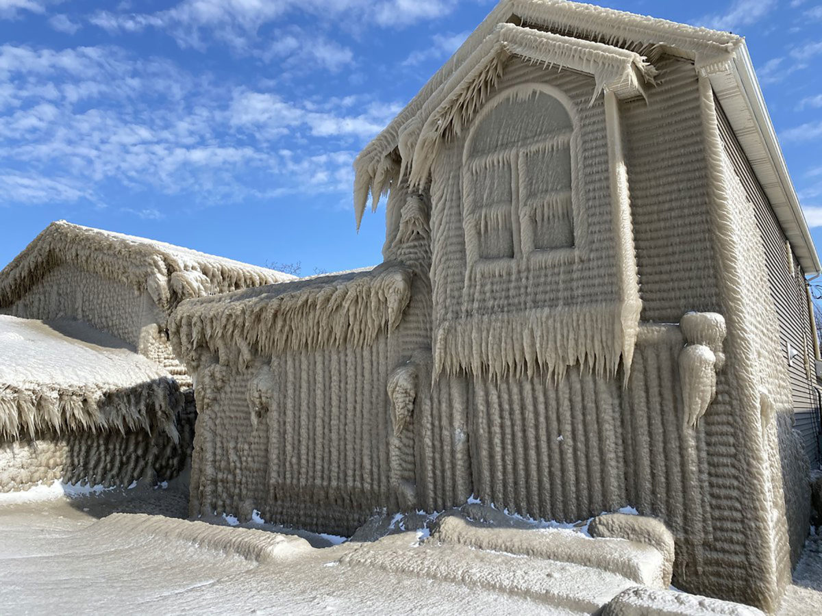 The ice covering the houses is up to 3 feet thick. (Credit: Ed Mis)