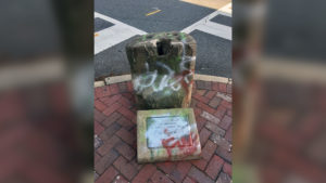 The 800-pound slave auction block was removed from a downtown corner after nearly two years of deliberation among City Council