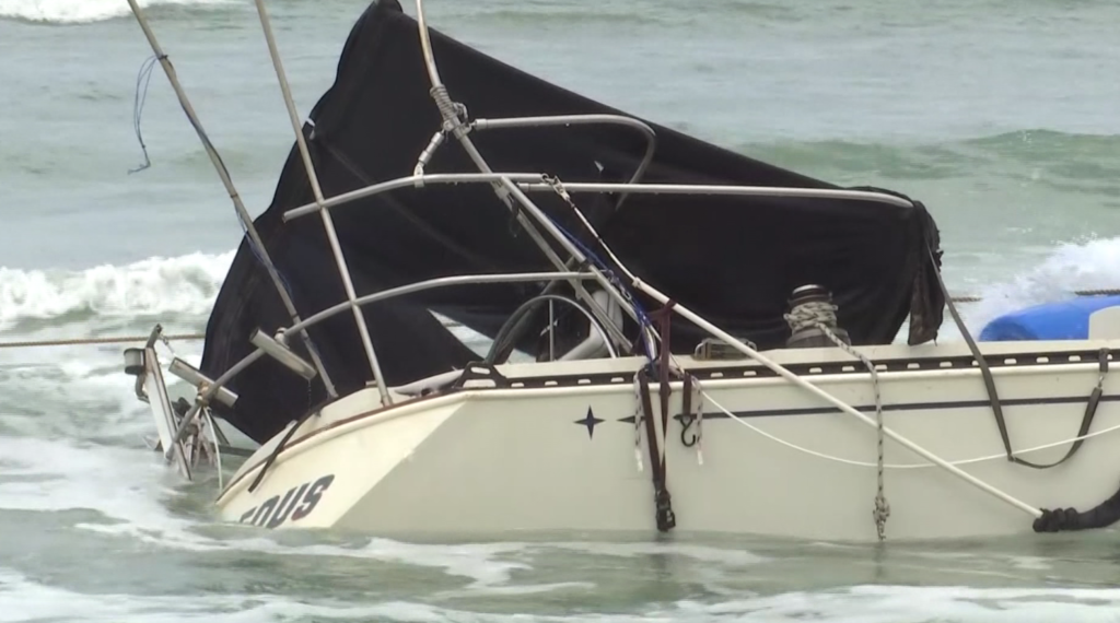 Storms wash beached boat and debris onto North Naples beach