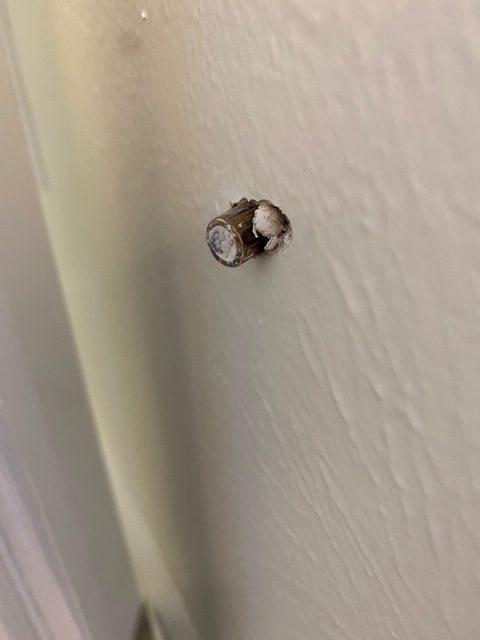 bullet in wall