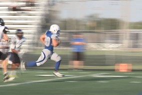 Barron Collier runs past Ida Baker 35-13.