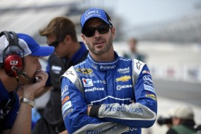 Jimmie Johnson looks on before qualifying for Sunday's NASCAR Sprint Cup series auto race, Friday, May 29, 2015, at Dover International Speedway in Dover, Del. (AP Photo/Nick Wass)