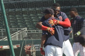 Big Papi brings Mookie Betts in for a hug.