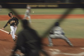 Vikings score a run in Tuesday night's game against Barron Collier.